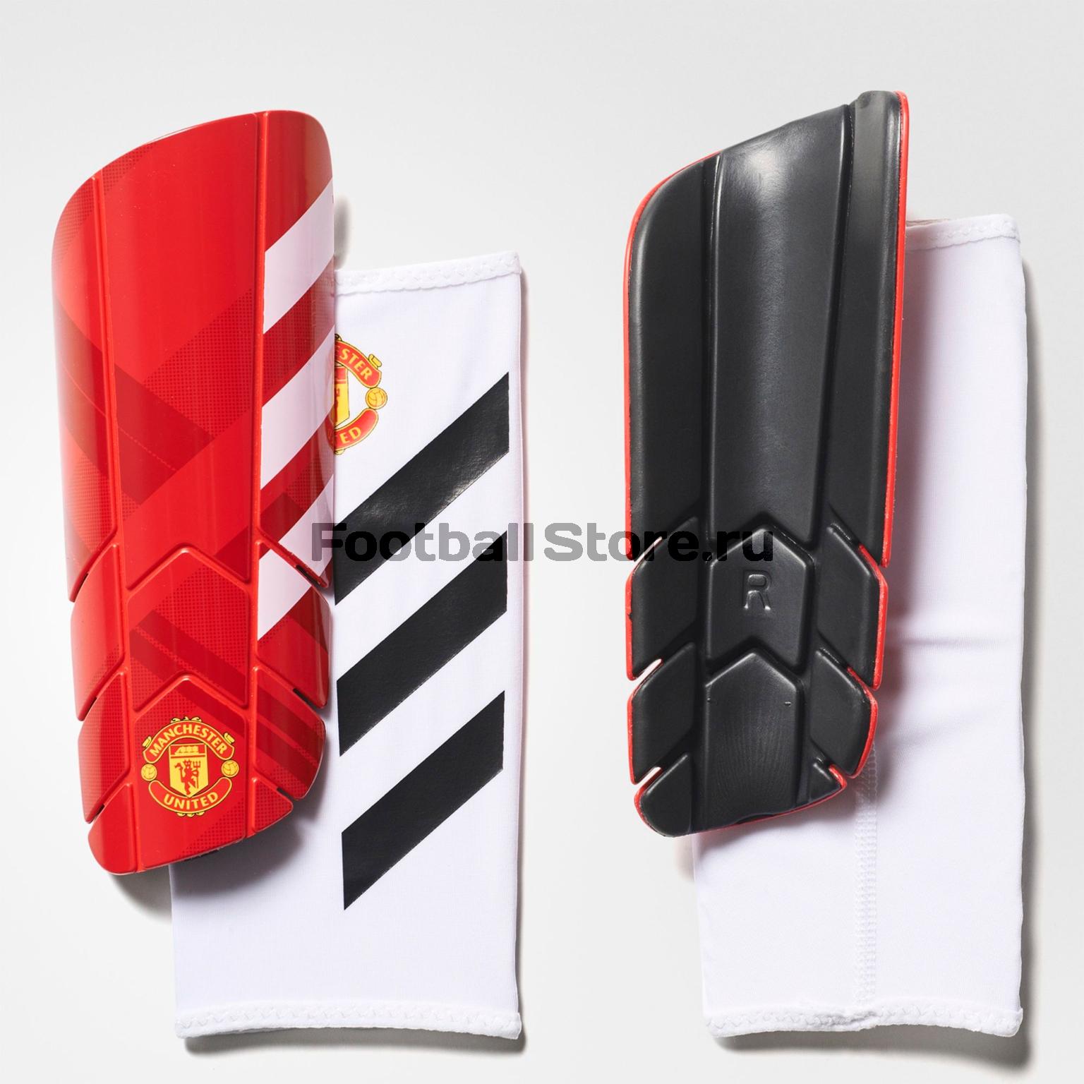 Защита ног Adidas Щитки футбольные Adidas Manchester United Pro Lite BR5314